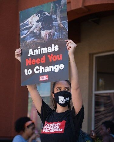SOS End Speciesism protest sign